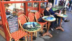 Tourists in the parisian street café Stock Footage