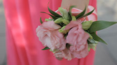Nice pink flower  accessory on the bridesmaid hand - stock footage