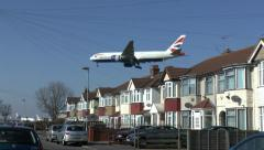 BA Boeing 777 passing close to houses while landing at London Heathrow Airport. Stock Footage