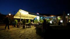 People near summer restaurant in Greece Stock Footage