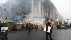 Political crisis. People near burnt house of trade union in Kiev Stock Footage