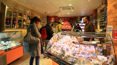 Customers in the French cheese shop Stock Footage