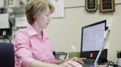 mature female network admin with headache works in office - stock footage