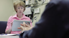 woman network admin using tablet pc discusses with coworker - stock footage