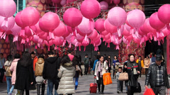 Stock Video Footage of Hong Kong Chinese New Year red lanterns attract tourists China Asia