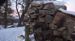 Person grabbing fire wood in winter weather Stock Footage