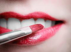Closeup female red pink lips with makeup lipstick brush Stock Photos