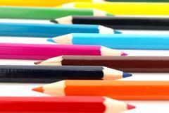 Row of wooden colour pencils Stock Photos