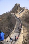 Chinese People Walking Along The Great Wall of China in Beijing - stock photo