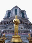 budha statue stand front of ancient big pagoda in wat arun - stock photo