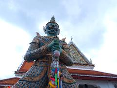 The giant statue in wat arun temple Stock Photos