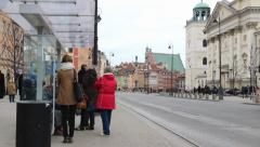 Warsaw, Poland. People waiting at the bus stop in the old town. Stock Footage