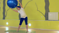 A pregnant woman doing exercises with the ball, yoga Stock Footage