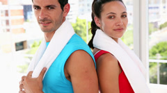 Fit couple smiling at camera Stock Footage