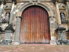 old massive door of cathedral - stock photo