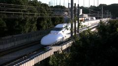 Shinkansen Bullet Train passing bridge in Japan Stock Footage