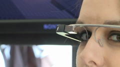 WOMAN WEARING TECHNOLOGICAL TECH FUTURISTIC GOOGLE TYPE GLASSES Stock Footage