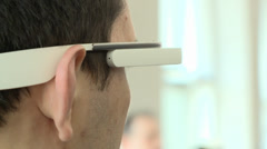 MAN WEARING TECHNOLOGICAL TECH FUTURISTIC GOOGLE TYPE GLASSES Stock Footage