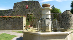 Fountain at the entrance to the town of Ternand France (1) Stock Footage