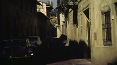 Vintage Moped and Red Sports Car Italy 16mm Stock Footage