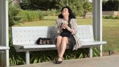 Joyful woman counts cash in her purse Stock Footage