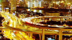 Busy urban traffic on overpass bridge at night,shipping on river. Stock Footage