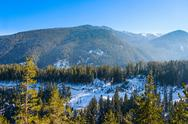 Stock Photo of mountain landscape in sunny winter frosty day with blue clear sky.
