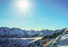 Stock Photo of winter mountain landscape against the blue sky. peaks of pirin mountain