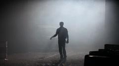 Silhouette  of male model walking in smoke Stock Footage