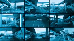 Cctv split screen of street, monochrome look Stock Footage