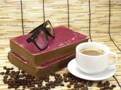 old book and glasses on bamboo - stock photo