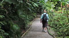 St Lucia woman walks botanical garden HD 1672 Stock Footage