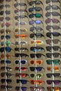 display of modern sunglasses in a store - stock photo