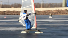Slalom at  winter windsurfing Stock Footage