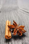 cinnamon and anise on the wooden background - stock photo