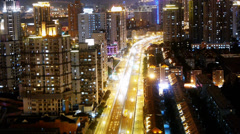 Busy urban traffic with streaking lights trail at night,shanghai china. Stock Footage