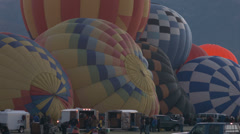 Hot air balloons filling up and glowing Stock Footage
