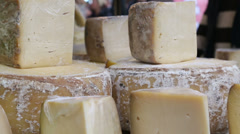 Slice of cheese on the farmer market Stock Footage