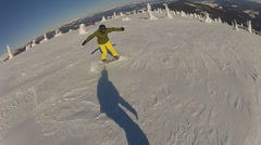 The snowboarder dance while riding, have fun and tease Stock Footage