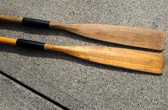 two old oars - stock photo