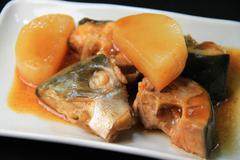 Yellowtail simmered with daikon - stock photo