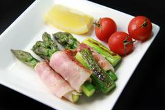 Bacon-wrapped asparagus Stock Photos