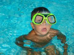 Boy in Swimming Pool Stock Photos