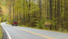Recreational Vehicles Traveling Through Pisgah Forest in Fall Stock Footage