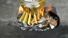 Burn goldend and silver paper Stock Footage
