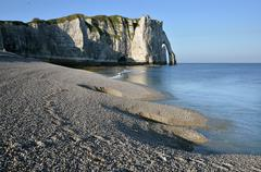Pebble beach and cliff of Etretat in France Stock Photos