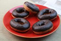 Chocolate donuts Stock Photos