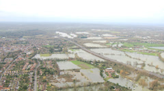 Floodwater nr homes Southwest England, UK Stock Footage