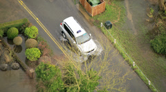 Car moving on flooded roads rural areas, Southwest, UK Stock Footage