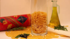 Penette falling into a glass cylinder, dried Italian pasta, cuisine, slow motion Stock Footage